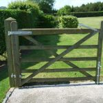 Five bar wooden gate in garden