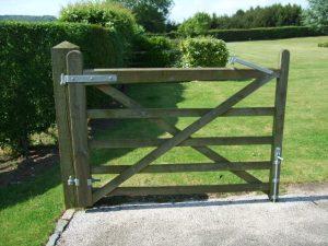 Five bar wooden gate in garden