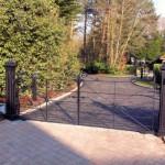Black metal gates on tarmac driveway