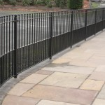 Black Metal Railings On Paved Footpath