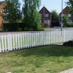 White picket fencing around garden in housing estate