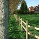 Wooden Post & Rail Fencing With Barbed Wire