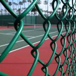 Chain link security fence around tennis court