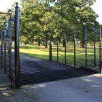 Black steel deer grid on country park road