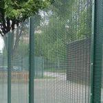 green fortex fencing around a school