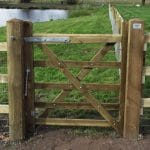 Wooden 5 bar gate with post and rail fencing