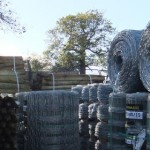 Fence posts wire and netting stock in outside yard