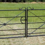 Black metal estate fencing gate in field