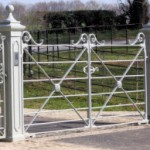 White estate fencing gate on driveway