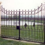 Lakeside decorative metal gate on driveway