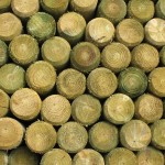 Redwood stacked wooden fence posts