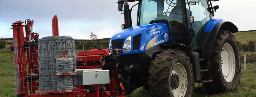Suddenstrike Fencing tractor with pro fencer netting in field