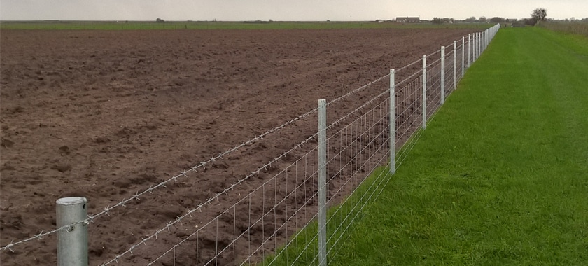 Clipex Fencing between mud and grass fields