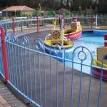 Blue bow top fencing around play area