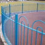 Blue double bow top fencing on park