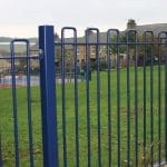 Blue square top railings on grass park