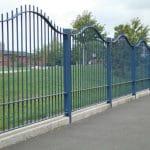 Blue metal wave fencing on