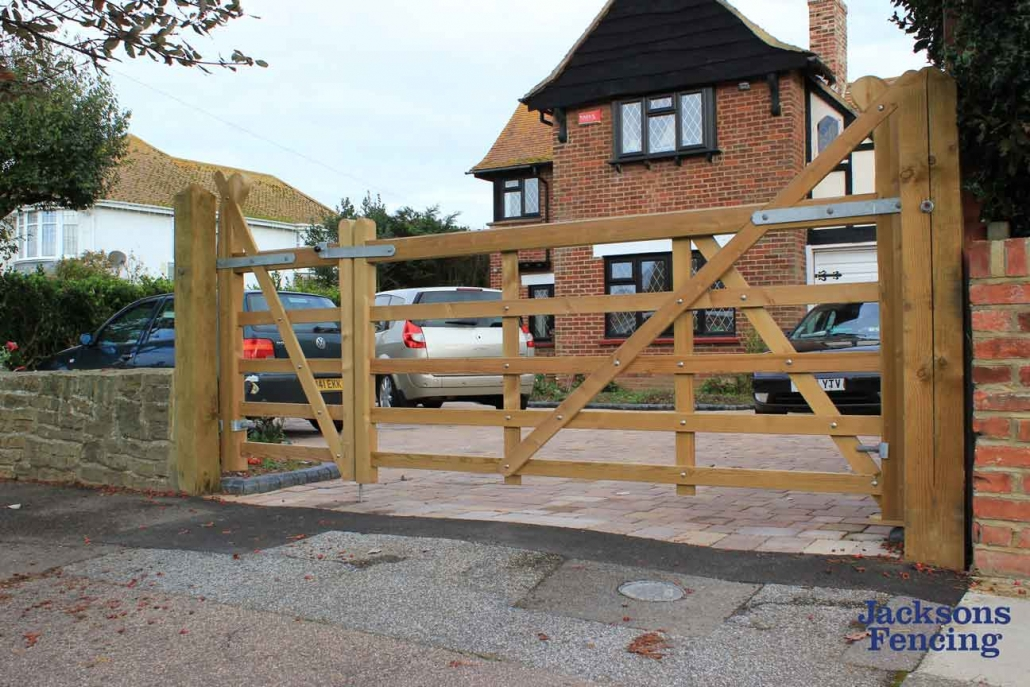 Wooden 5 bar gate on driveway