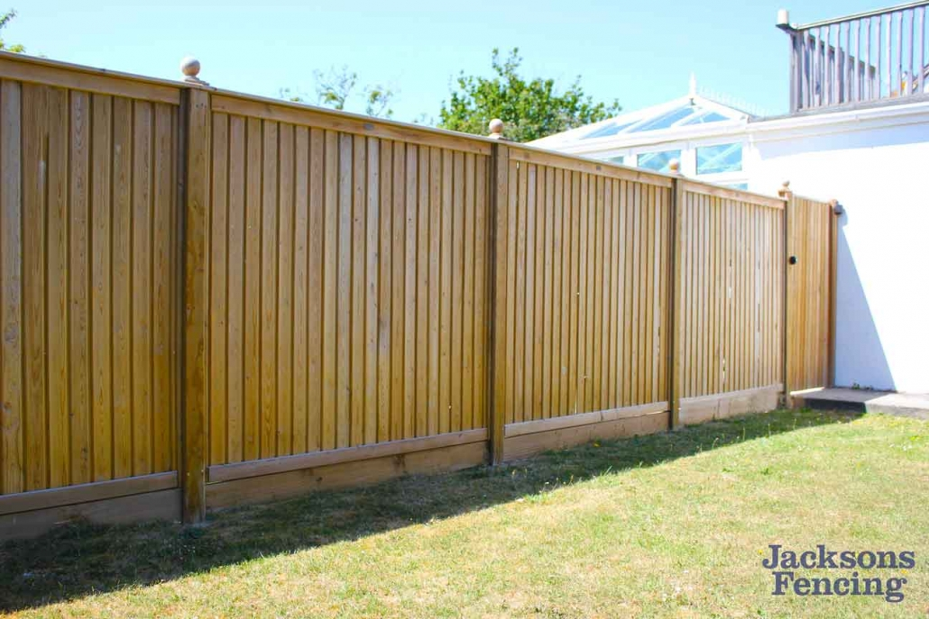 Tongue and groove wooden fencing in back garden