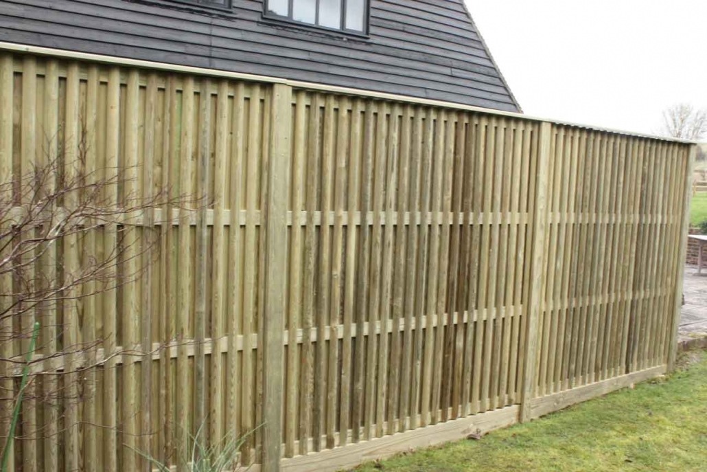 Wooden tudor fence panels in garden