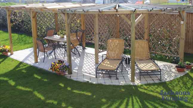 Round pergola on paved area of garden